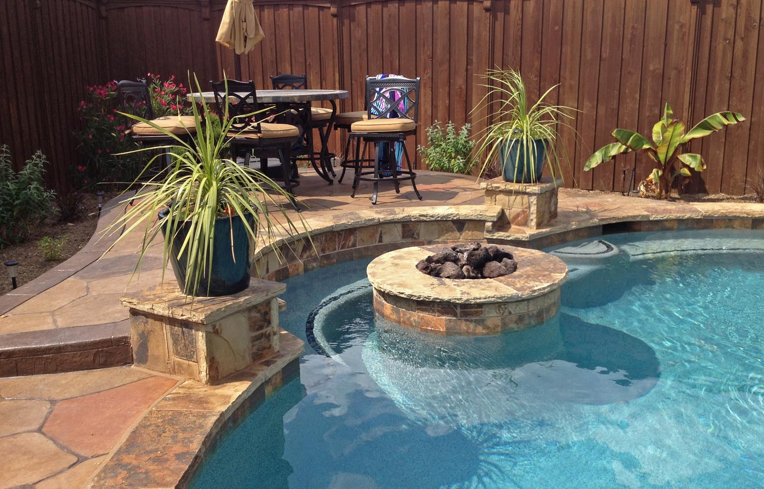 Fire Pit Inside Pool With Bench In Frisco · Free Form ...