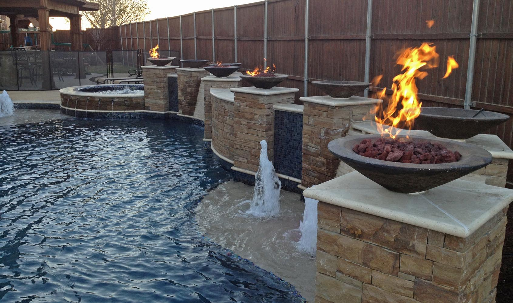 Freeform pools photo gallery custom pools images dallas for Pool fire bowls