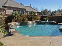 Free Form Pool and Spa with Ledger Stone Raised Bond Beam in Allen