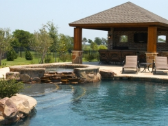 Free Form Pool and Spa with Patio Cover, Stamped Concrete and BBQ Island in Prosper