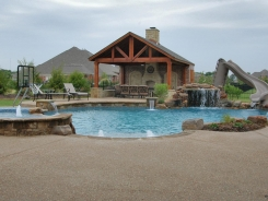 Free Form Pool with Grotto and Patio Cover with Fireplace in Lucas