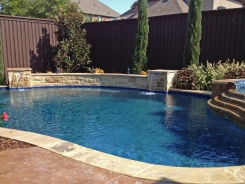 Free Form Pool with Spa and Raised Bond Beam in Frisco