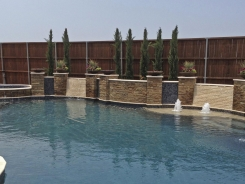 Free Form pool, Concrete Fire Bowls, Iridescent Glass Tile, Travertine and Stone Walls and Spa in Frisco (2)