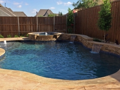 Iridescent Tile on Spa with Tiered Spillway and Raised Bond Beam with Water Features in Frisco