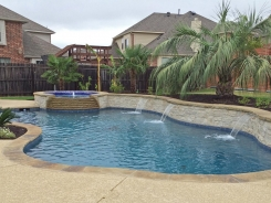 Iridescent Tile on Spa with Tiered Spillway and Raised Bond Beam with Water Features in Little Elm