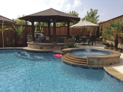 Iridescent Tile on Spa with Tiered Spillway and Swim Up Bar in Plano