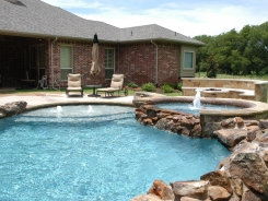 Pool and Spa with Fire Pit and Tanning Ledge with Bubblers in Lucas