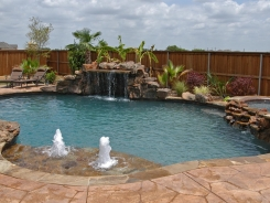 Stone Grotto and Tanning Ledge with Bubblers and Pebble Sheen in Prosper
