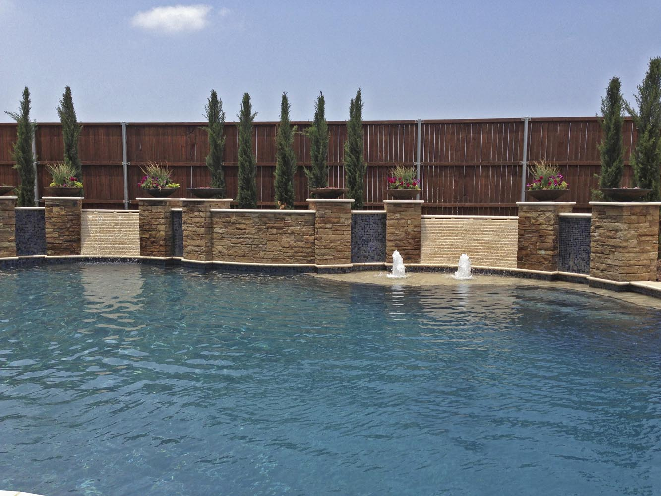 Pool Design Dallas pool feature highlights Free Form Pool Concrete Fire Bowls Iridescent Glass Tile Travertine And Stone Walls