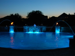 Geometric Pool with Blue Granite Pebble Sheen, LED Lighting and Copper Fire and Water Bowls in Frisco (1)
