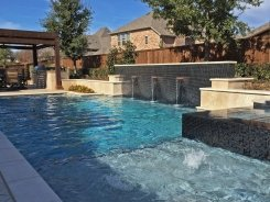 Geometric pool, Copper Water Bowls, Iridescent Glass Tile and Travertine Walls and Spa in Allen (1)