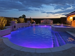 Grecian Pool, with Bubblers, LED Lighting, Travertine Water Bowls and Travertine Walls and Columns in Frisco (4)