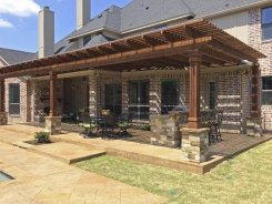 Cedar Arbor with Stone Column Bases and Stone BBQ Island in Frisco (1)