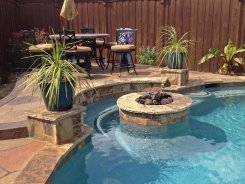 Fire Pit inside Pool with Bench in Frisco