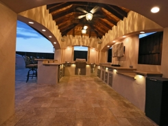 Stucco Pavilion, Noche Travertine with BBQ Island, Lighting and Cedar Beams in Frisco (1)