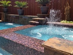 Glass Tile Spa with Aqua Blue Pebble Sheen in Plano