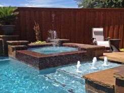 Glass Tile Spa with Bubblers and Aqua Blue Pebble Sheen in Plano