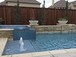 Iridescent Glass Tile Spa with Aqua Blue Pebble Sheen and Bubblers in Frisco
