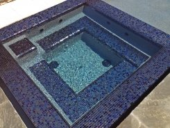 Iridescent Glass Tile Spa with Blue Granite Pebble Sheen in Frisco