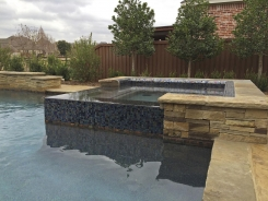 Iridescent Glass Tile Spa with Pebble Sheen in Frisco
