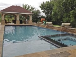Geometric Pool and Spa, Pool Cover, Travertine Water Bowls with Stone Walls and Columns in Frisco