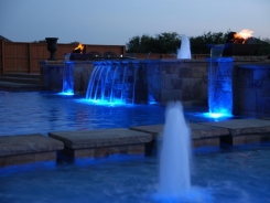 Geometric Pool with Blue Granite Pebble Sheen, LED Lighting and Copper Fire and Water Bowls in Frisco