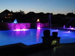 Geometric Pool with LED Lighting and Copper Fire and Water Bowls in Frisco