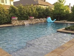 Geometric pool, Raised Bond Beam, Stone Water Bowls with Aqua Blue Pebble Sheen in Frisco