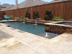 Geometric pool and Spa, Raised Bond Beam, with Ocean Blue Pebble Sheen in Frisco